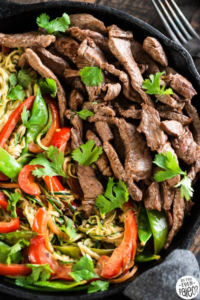 Closeup of Thai beef stir fry in a large cast iron skillet