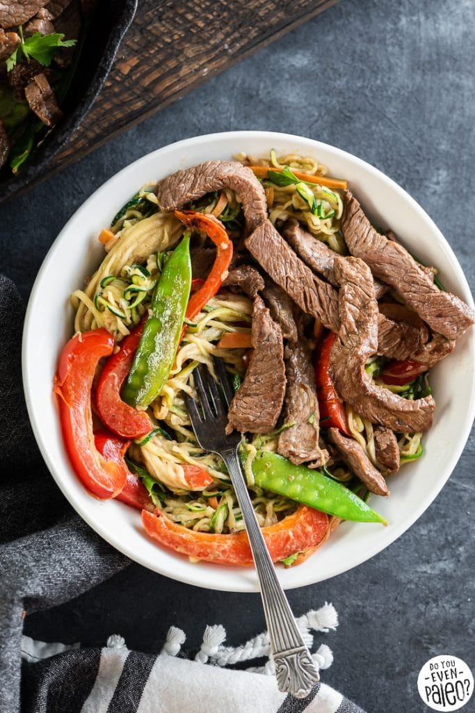 Bowl full of Thai beef stir fry with zucchini noodles and vegetables
