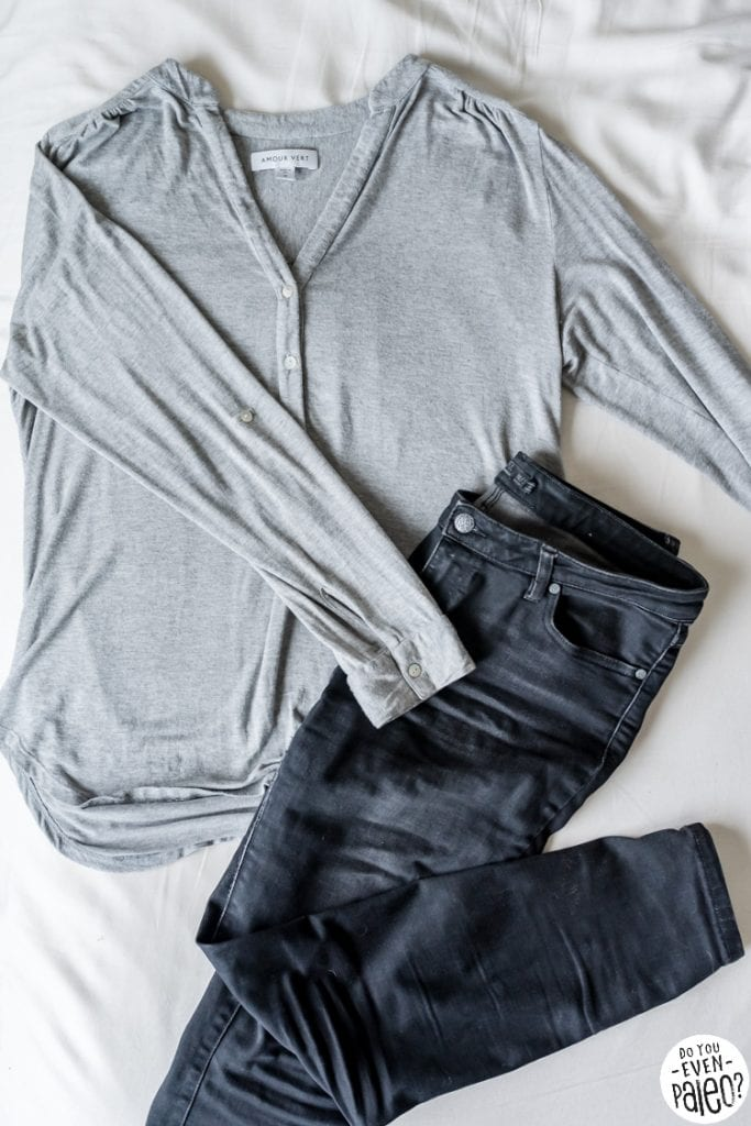 Flatlay of a grey henley and black jeans