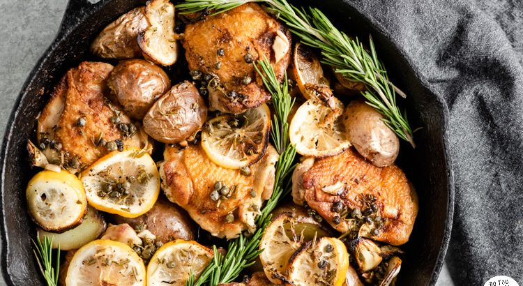 Closeup of lemon rosemary chicken thighs with potatoes