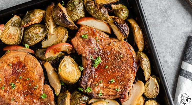 Closeup of sheet pan pork chops with brussels sprouts and apples