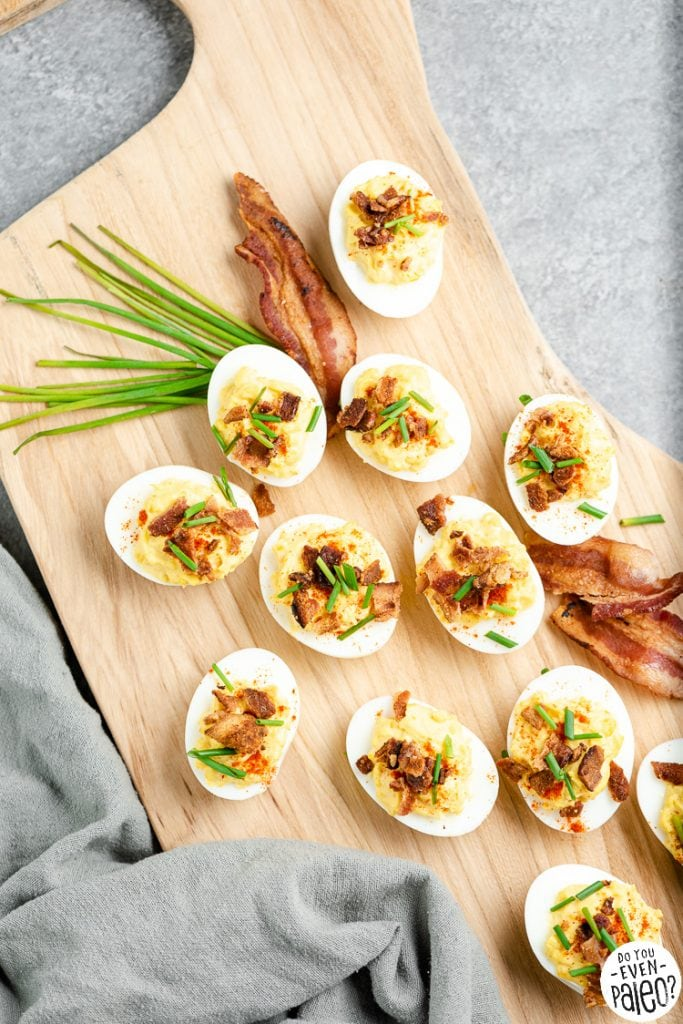 Chive bacon deviled eggs on a wooden platter
