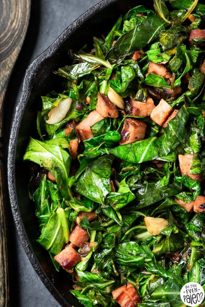 Closeup of skllet collard greens with ham
