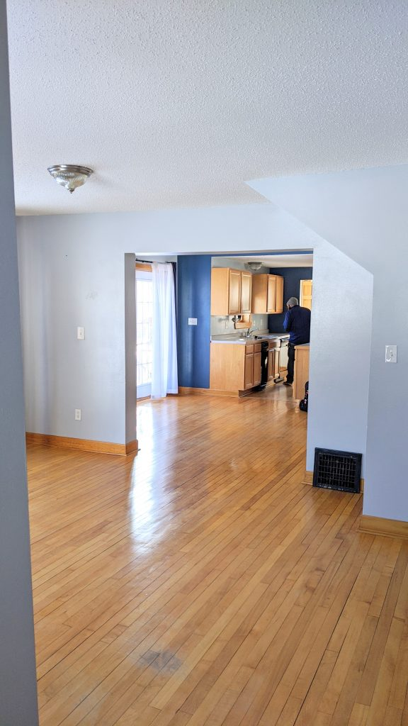 Interior of home with hardwood floors and light blue walls