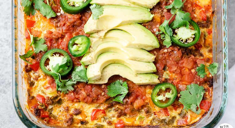 Closeup of chorizo breakfast casserole garnished with avocado and jalapeno