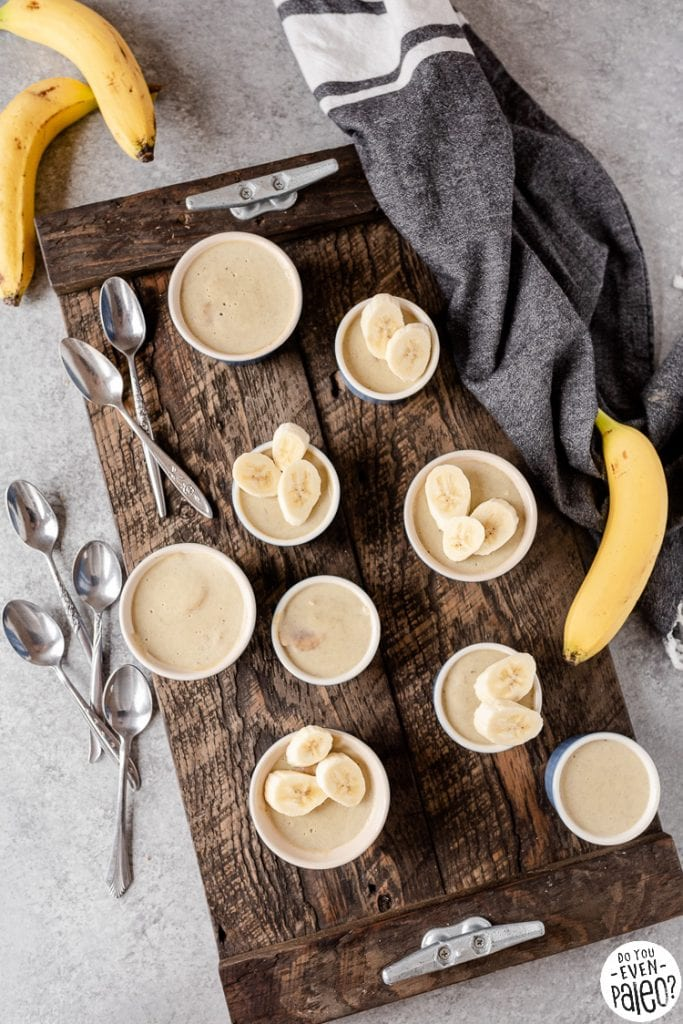 Bird's eye view of a tray of banana custards in ramekins