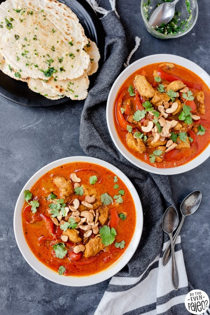 Bowls of paleo chicken curry with flatbread