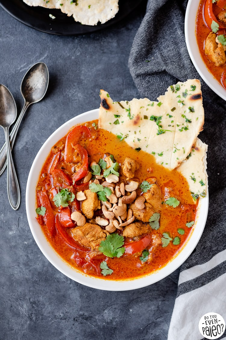 Bowl of paleo chicken curry with flatbread