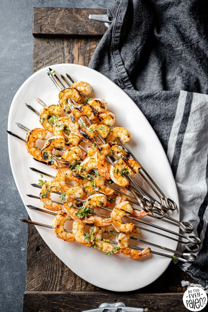 Platter with skewers of herbed grilled shrimp