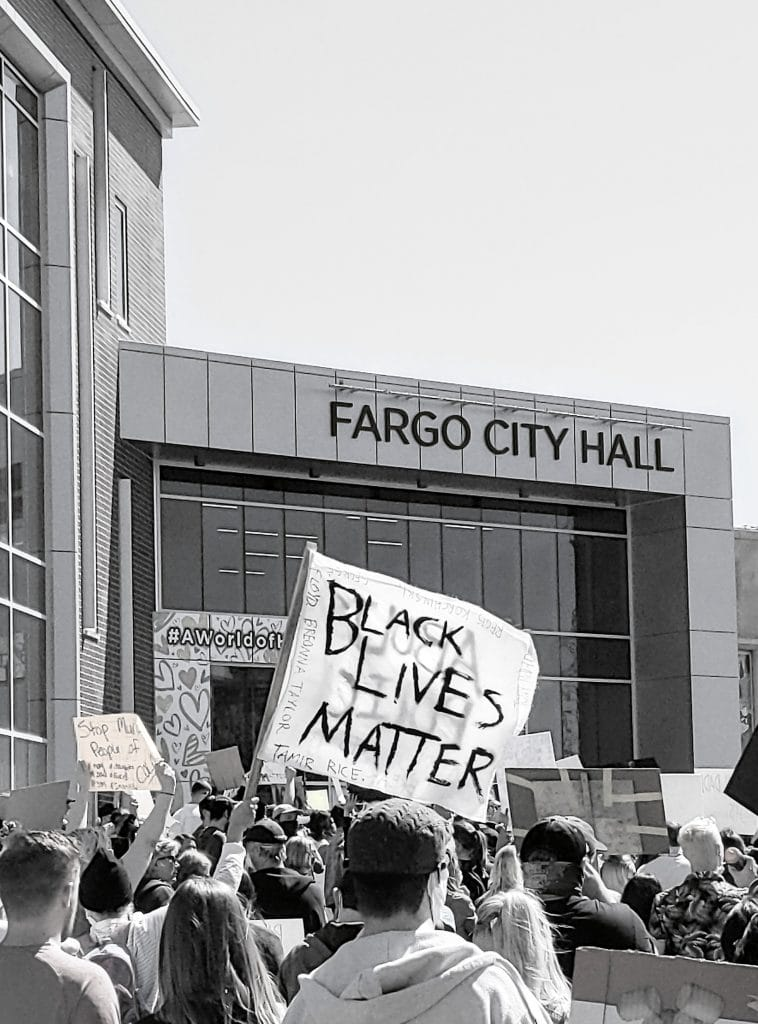 Black lives matter flag at a protest outside of Fargo City Hall