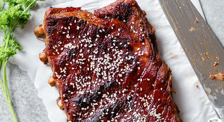 Sticky sweet pork ribs garnished with sesame seeds