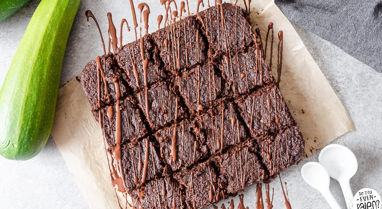Sliced zucchini brownies drizzled in chocolate