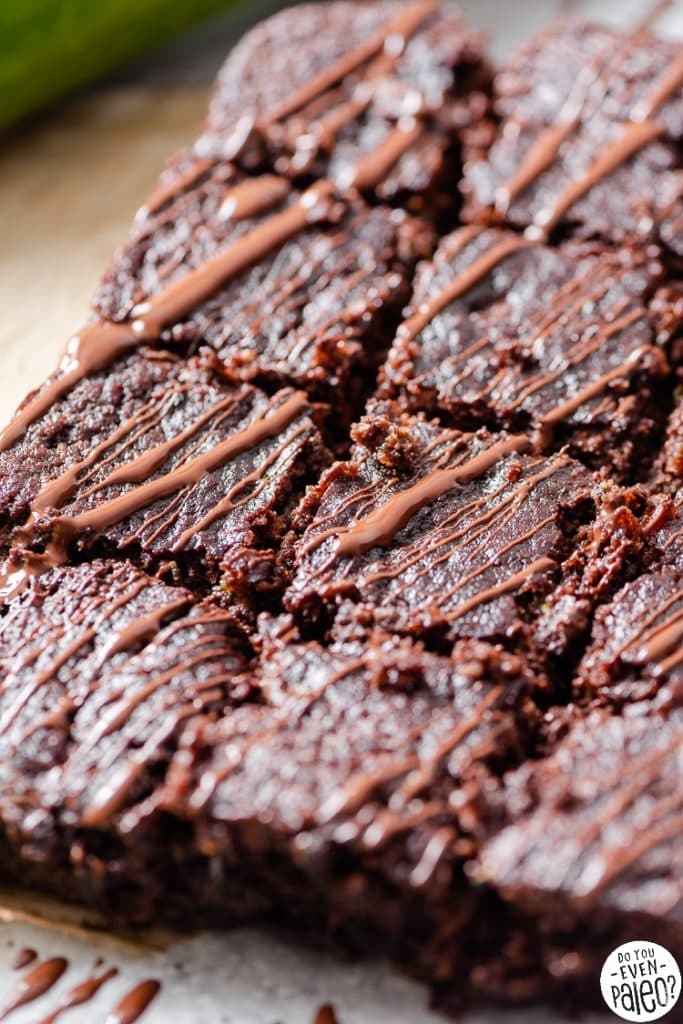 Zucchini brownies drizzled in chocolate