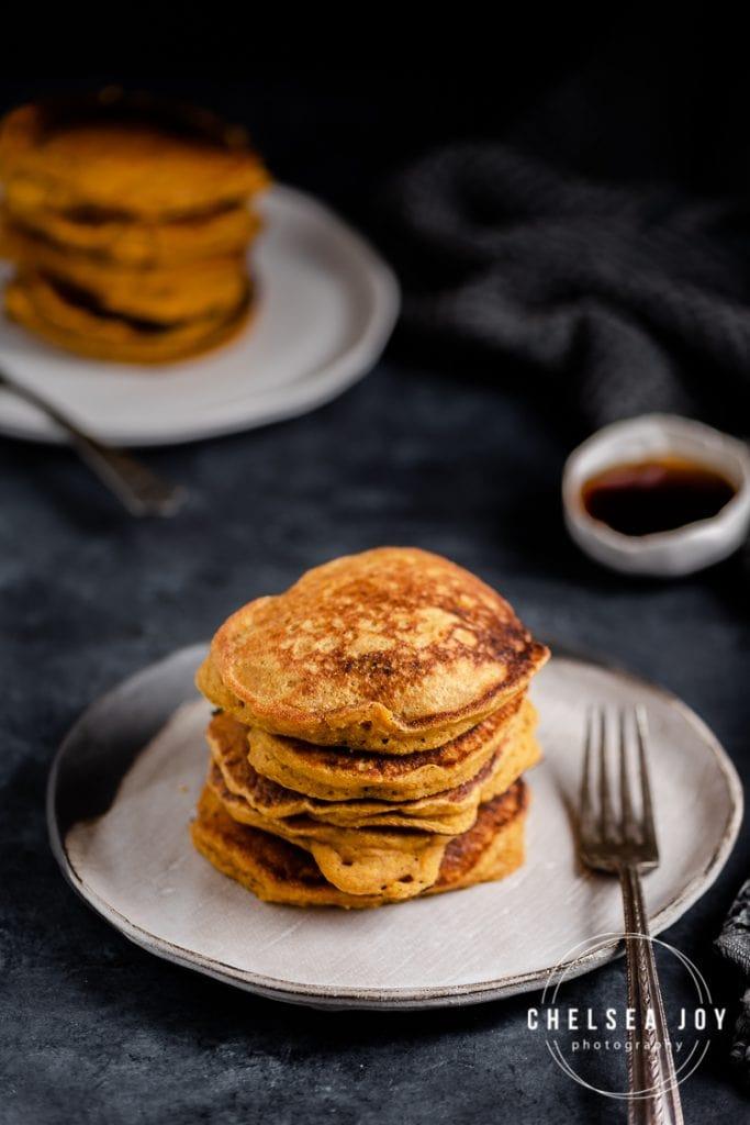 Stacks of pancakes on ceramic plates