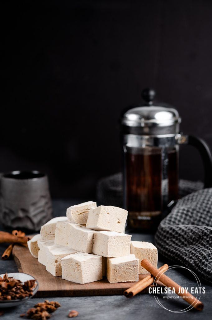 Pile of homemade gingerbread marshmallows in a dark scene
