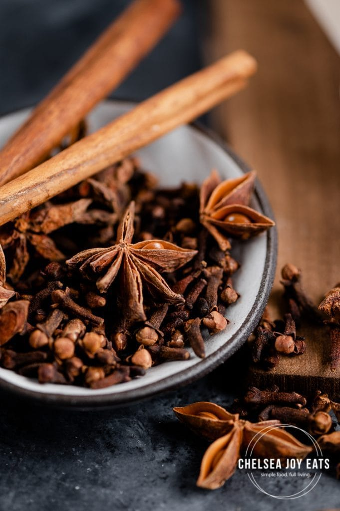 Closeup of clove, star anise, and cinnamon in a small dish