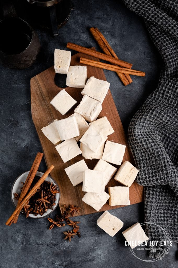 bird's eye view of gingerbread marshmallows arranged across a wooden board