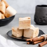 Homemade snickerdoodle marshmallows displayed on a plate