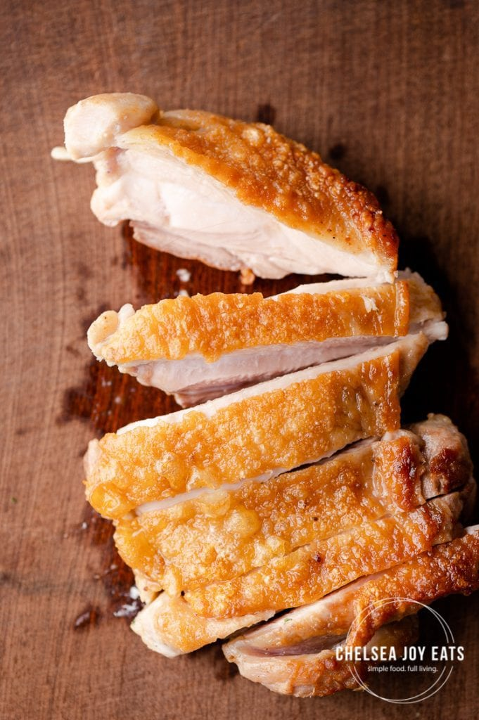 Closeup of a sliced pan-fried chicken thigh