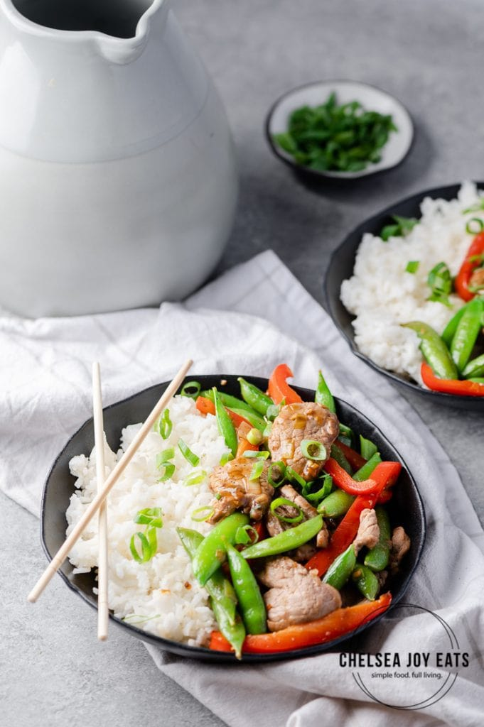 Bowls of stir fry with rice on a dinner table