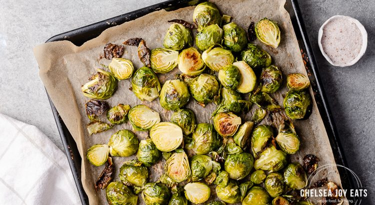 Tray of simply roasted brussels sprouts on a concrete background