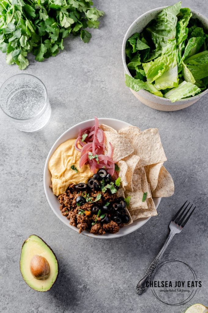 Weeknight taco bowl recipe with taco meat base and a variety of topping suggestions